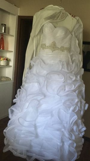 New wedding dress . Never worn other than sizing . Size 5 . Only 2 years old and had been in a protective bag since bought .
