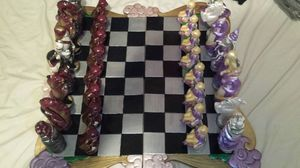 Chess set. ceramic board not sure what the pieces are