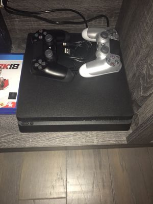 Brand new PlayStation 4 with games and extra controller