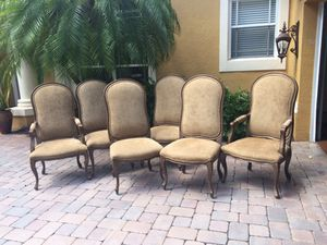 8 pc Italian Art Design carved upholstered dining room chairs.