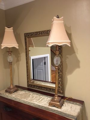 Two lamps and a mirror