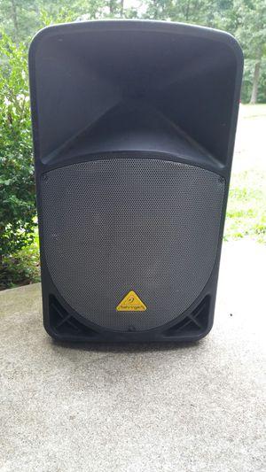 Behringer 15 inch powered speakers.