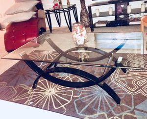 Black metal framed glass top coffee table