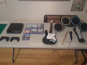 PS4, 7 games and rock band set