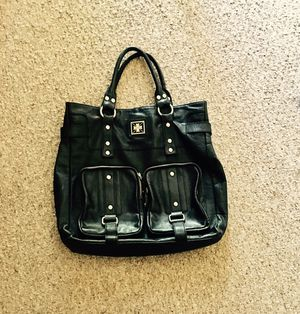 Guess bag has small tear that can easily be fixed fed otherwise looks new