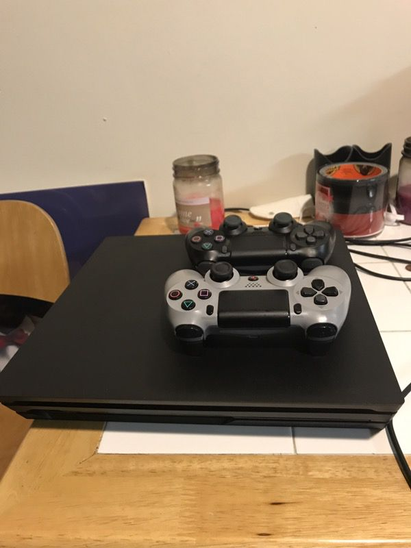 PS4 Pro 1tb System with two controllers and all cords included! And comes with Injustice 2!! Also it has a warranty on it!