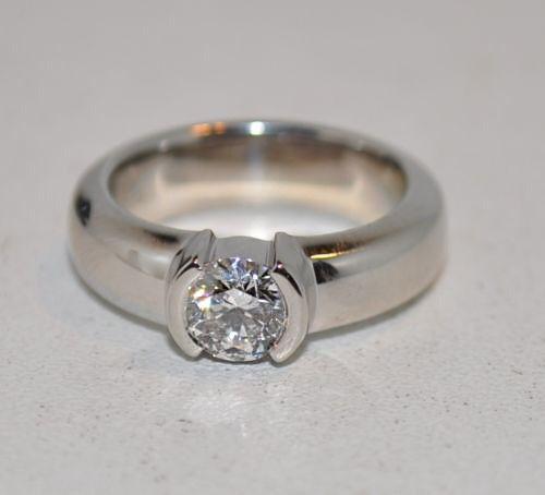 Tiffany diamond + platinum engagement ring
