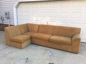 Caramel colored sleeper sofa