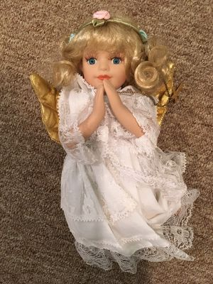 Porcelain praying angel doll on her knees
