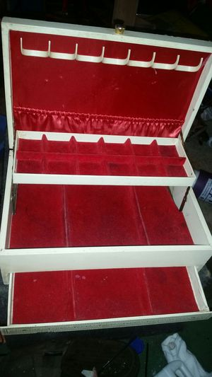 Vintage jewelry box with red velvet drawers