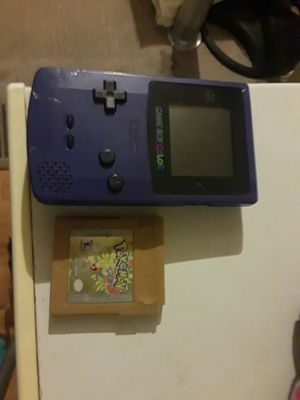 Purple Gameboy with Pokemon Gold everything works great firm on price