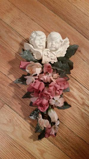 Floral cherub plaque