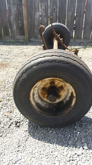 Snowmobile trailer axle and wheels