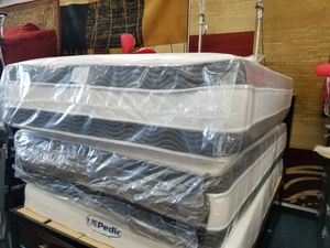 New in plastic quite size double-sided pillow top mattress and box spring