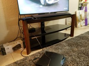 TV Stand with 3-in-1 swivel back mount. Supports up to 65 in.