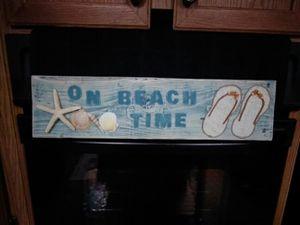 Beach sign with flip flops