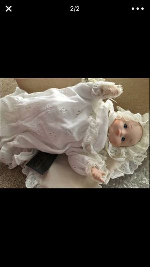 The baby porcelain doll is a wind up musical doll. Great Christmas presents, new still in the box $15