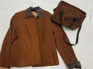 Custom make leather jacket and the purse and Argentina .barely used