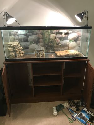 50 Gallon Freshwater Tank (Used as a turtle tank) with Nice Stand and Fluval 350 pump.