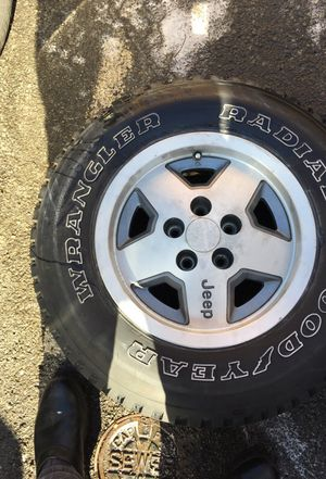 Have one Jeep Used Tire withe Rim 215/75/R15