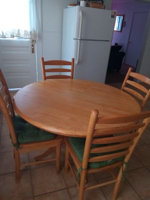 Oval Wooden Table With 4 Chairs
