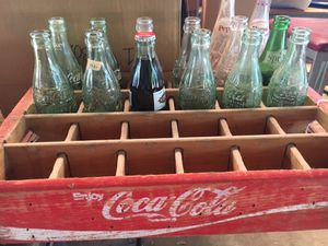 1915 Coca-Cola bottles and other bottles with crate