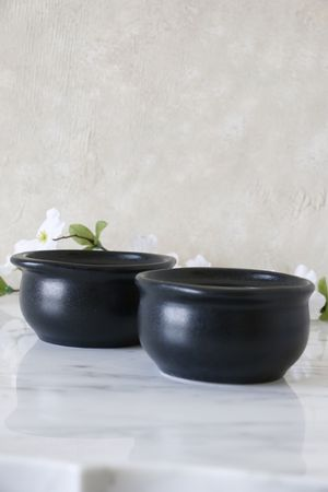 2 black ceramic bowls