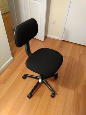 Office chair and stand lamp.