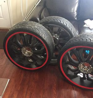 4 Universal 24inch rims with brand new tires and no center caps