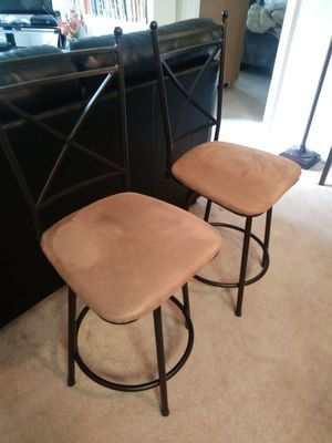TWO SPINNING CHAIRS