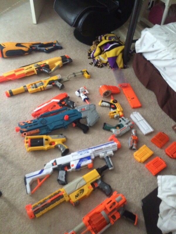 12 Nerf guns + ammunition and attachments $300 worth of Nerf guns at least