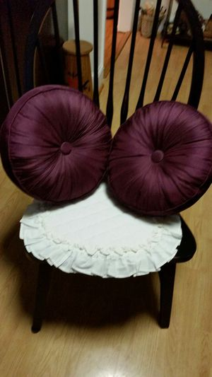 Pair of eggplant colored throw pillows