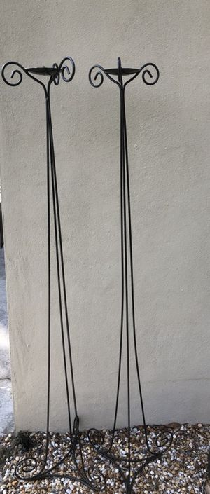 Metal tall candle holders about 5 foot tall