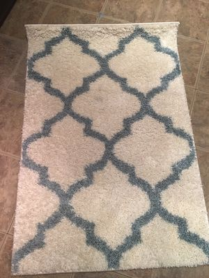 2 Ivory and blue accent rugs