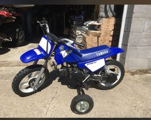 "Yamaha PW 50. With training wheels. Training wheels included. May need carburetor cleaned. Some scratches and a 1"" tear in seat."