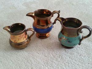 3 lusterware pitchers