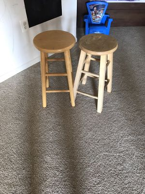 Two solid wooden bar stools. (Used Normal wear).