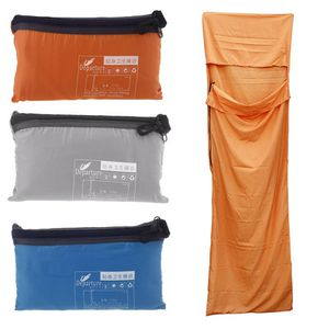 Orange compact light sleeping bags. Made of bed sheet material, might be water resistant.