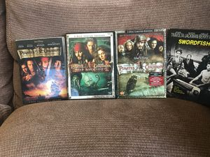 DVDs. Pirates of Carribbean (6 discs in 3 Cases), Swordfish