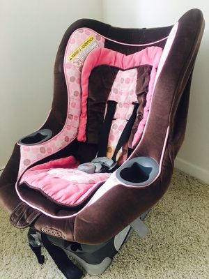 Pink and brown convertible seat