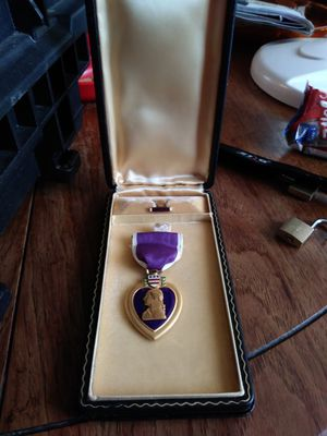 WWII PURPLE HEART IN ORIGINAL COFFIN CASE