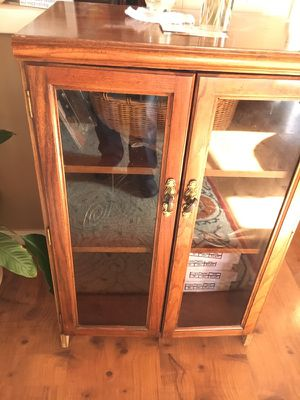 Oak cabinet with glass front doors