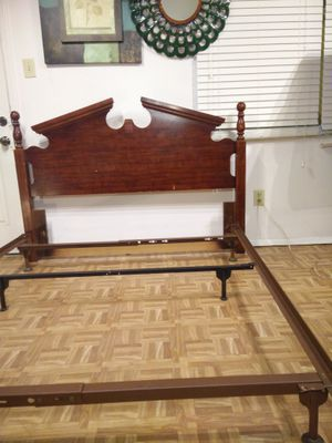 Queen bed frame in very good condition, pet free smoke free