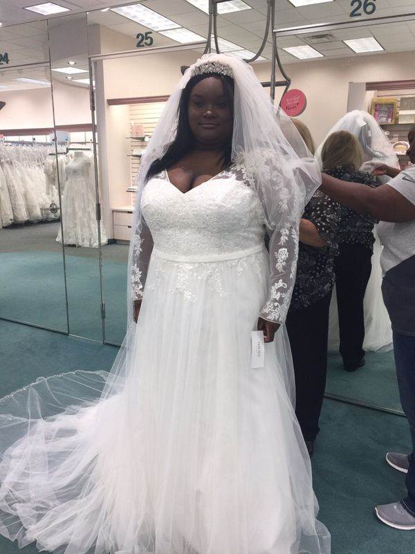 Long sleeve plus size wedding dress. Worn once & dry cleaned ...