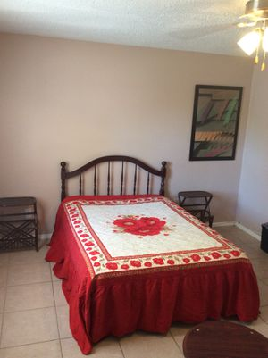 Bed room set with two night stans and a glass table
