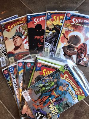 75 Superman comics in bags with boards