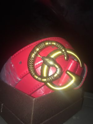 Red Gucci belt with snake buckle