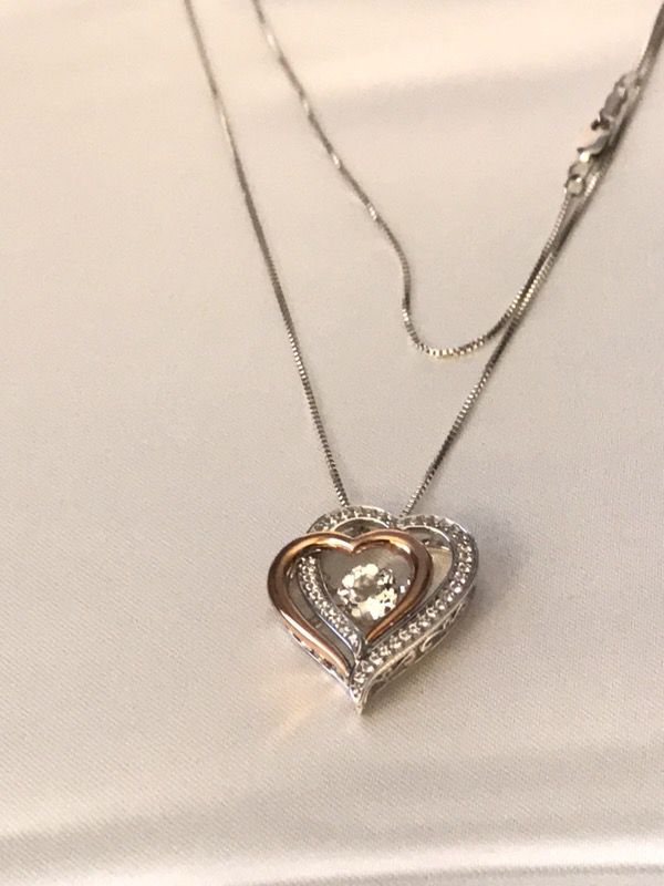 Jared silver and rose gold heart shaped white topaz studded