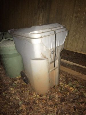 Commercial grade rolling trash can