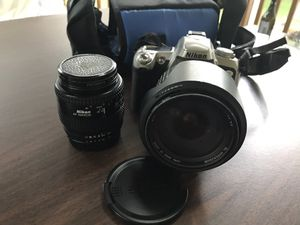 Nikon SLR N75 Camera with two lenses.